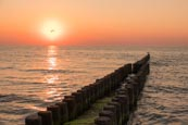 Sea With Groynes At Sunset At Ahrenshoop, Mecklenburg-Vorpommern, Germany