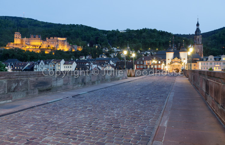 photo showing On The Alte Brucke With The Castle Behind, Heidelberg, Baden-Württemberg, Germany