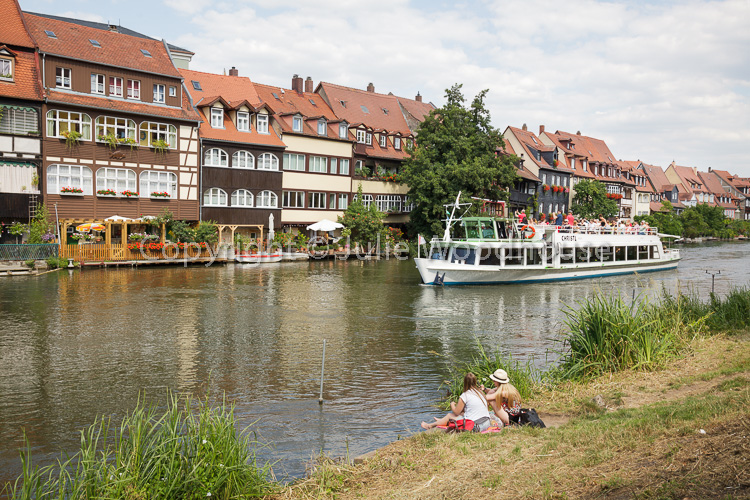 photo showing Little Venice, Former Fishermans District,  With Tourist Boat On The Regnitz River, Bamberg, Bavaria