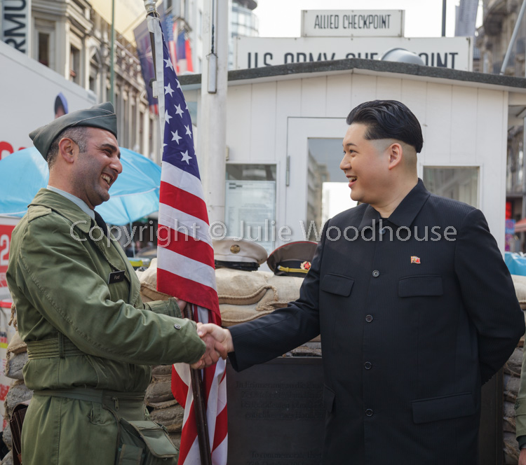 photo showing Kim Jong Un Impersonator With Border Guard At Checkpoint Charlie, Berlin