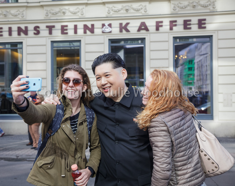 photo showing Kim Jong Un Impersonator At Checkpoint Charlie, Berlin