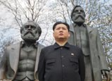 Kim Jong Un Impersonator With Marx And Engels Statue, Berlin