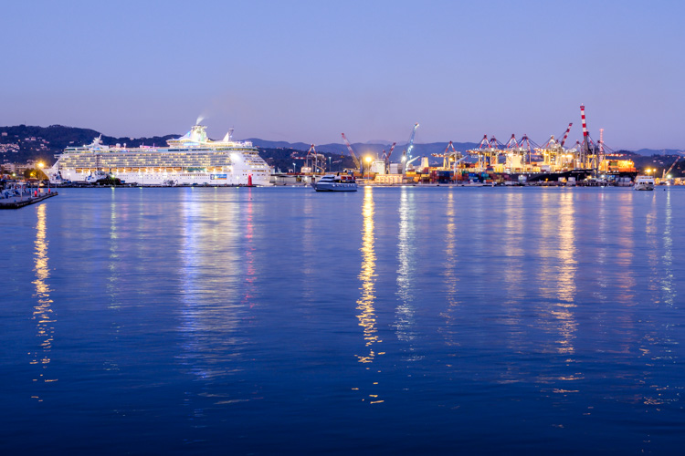 photo showing La Spezia Harbour, Container Port And Cruise Ship Royal Caribbean, Liguria, Italy
