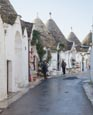 Typical Trulli With Gift Shops In Alberobello, Puglia, Italy