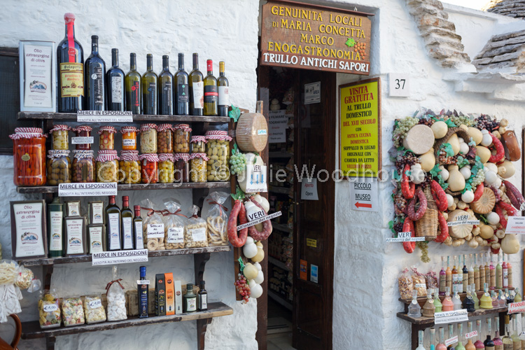 photo showing Trulli Souvenir Gifts And Local Products Shop In Alberobello, Puglia, Italy