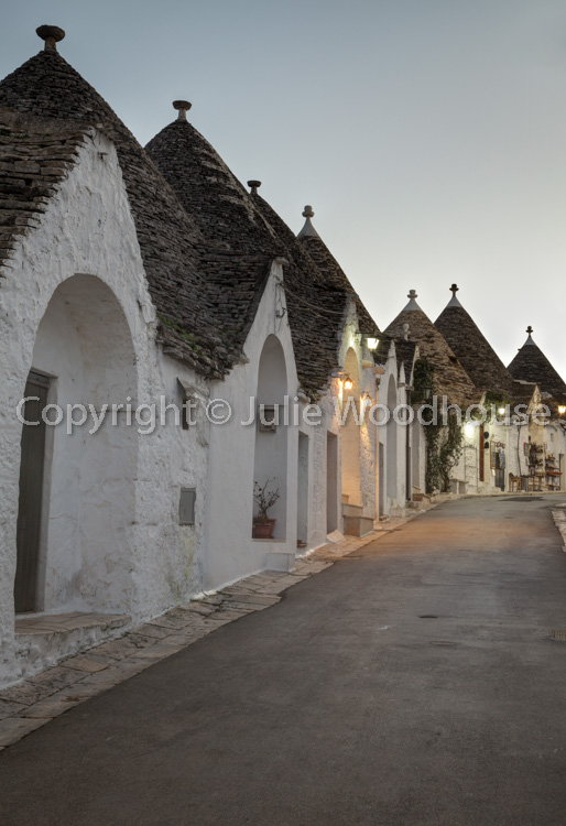 photo showing Street In The Trulli District Rione Monti In Alberobello, Puglia, Italy