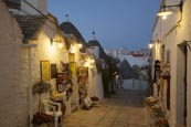 Street And Shops In The Trulli District Rione Monti In Alberobello, Puglia, Italy