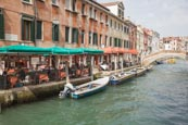 Canal With Outdoor Restaurant On Fondamenta San Lorenzo, Venice, Veneto, Italy