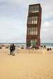 Thumbnail image of People on the beach at Barceloneta with Rebecca Horns sculpture  L'Estel Ferit (The Wounded Shooting