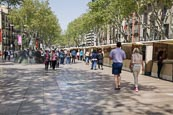 People Walking On La Rambla With Art And Souvenir Stalls, Barcelona, Catalonia, Spain